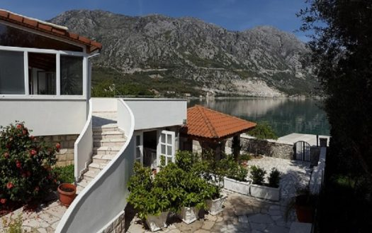 bay of kotor house with pier